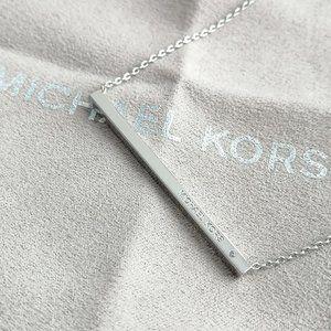 Michael Kors Jewelry - $115 😱 Michael Kors Silver Tone Logo Bar Necklace